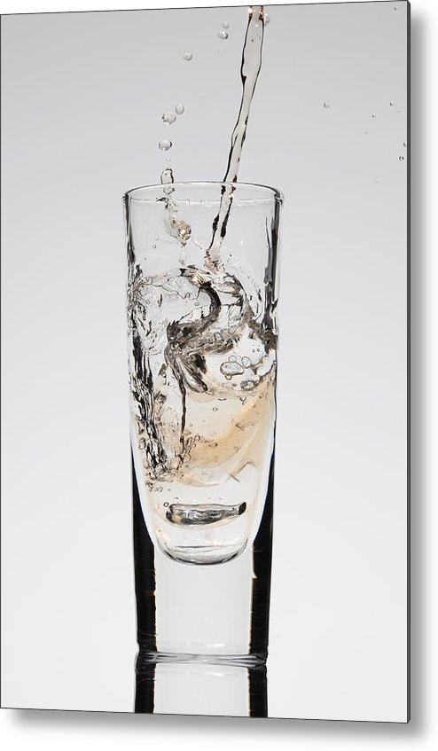 Vertical Metal Print featuring the photograph A Drink Being Poured Into A Glass by Dual Dual