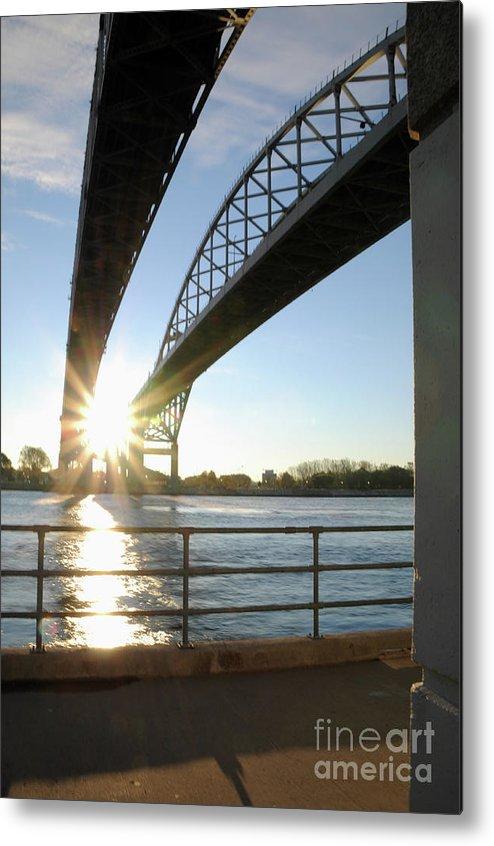 Sunrise Metal Print featuring the photograph Sunrise Blue Water Bridges by Ronald Grogan