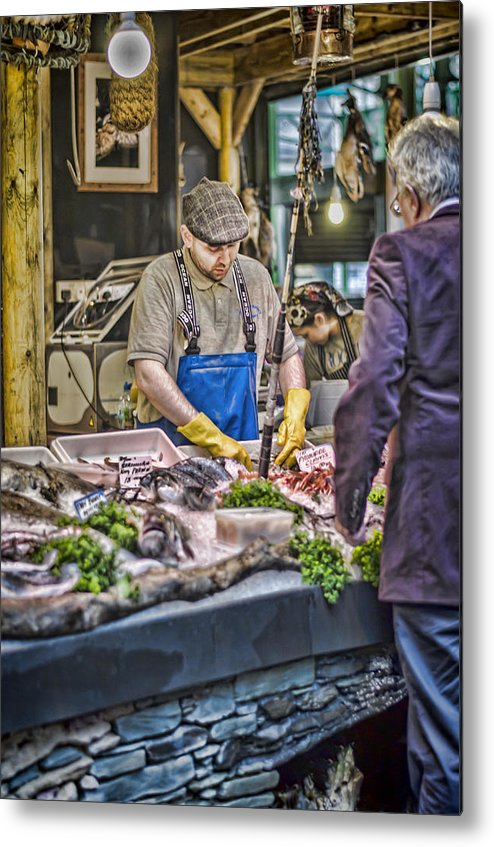 Fish Monger Metal Print featuring the photograph The Fish Monger by Heather Applegate