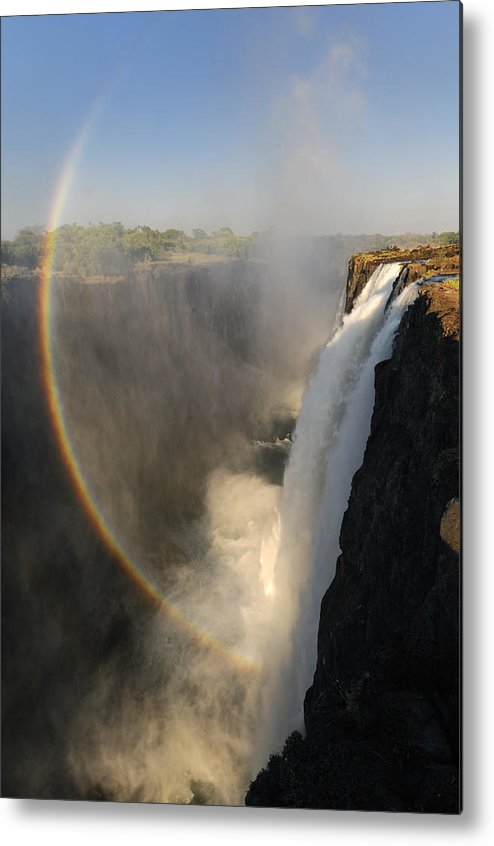 Rainbow At The Victoria Falls Metal Print featuring the photograph Victoria Falls by Christian Heeb