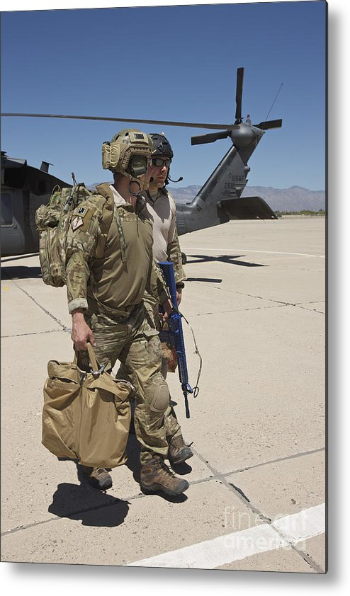 Exercise Angel Thunder Metal Print featuring the photograph Pararescuemen Walks Away From A Hh-60g by Terry Moore