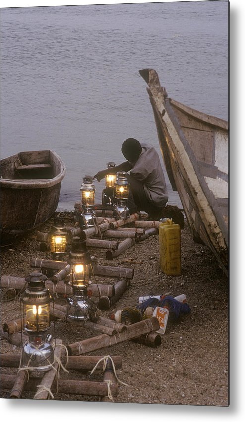 Uganda Metal Print featuring the photograph Fisherman Prepares Lanterns For Night by Michael S. Lewis