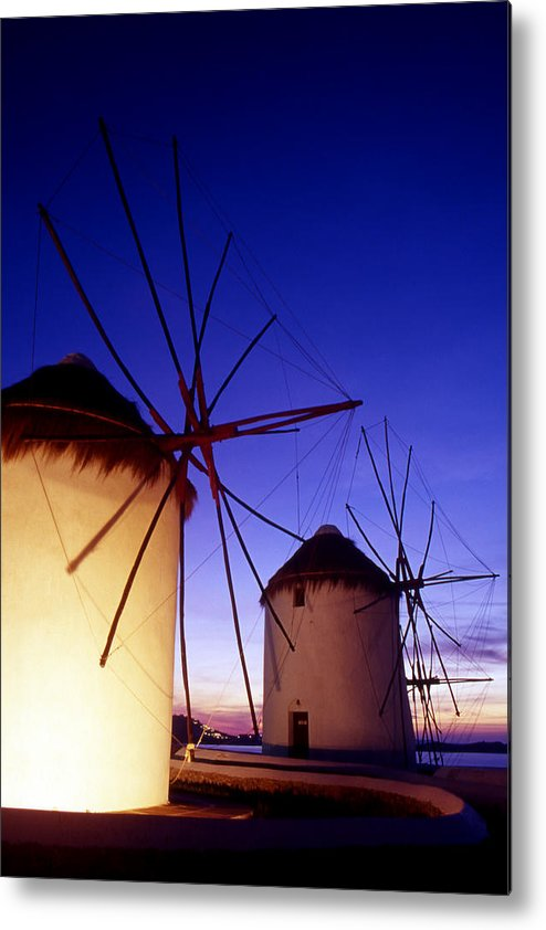 Architecture; Architectural; Cyclades; Mykonos Metal Print featuring the photograph Greece. Mykonos Town. Illuminated Windmills At Dusk. by Steve Outram