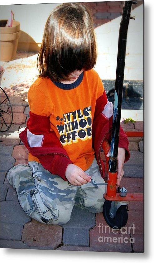 Boy Metal Print featuring the photograph Junior Mechanic by Bob Gardner
