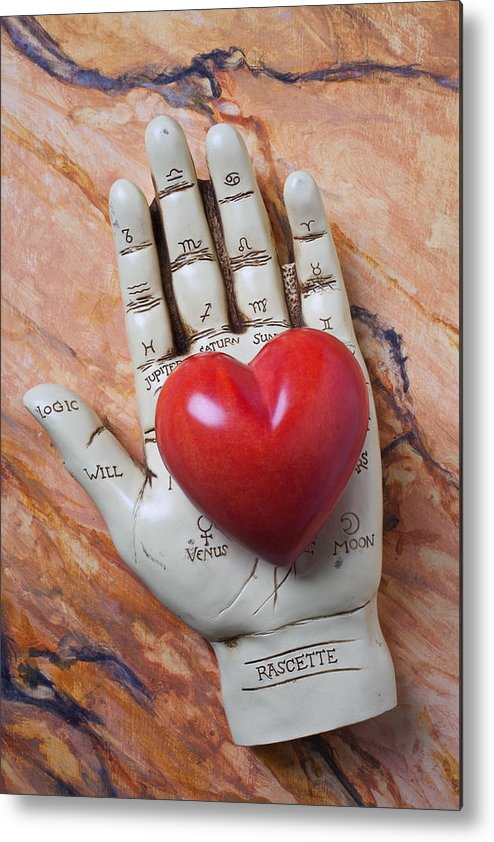 Palm Reader Hand Metal Print featuring the photograph Plam Reader Hand Holding Red Stone Heart by Garry Gay