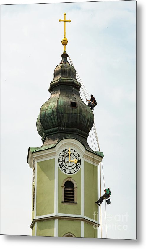 Aschach Austria Parish Church Churches Building Buildings Structure Structures Architecture Place Of Worship Places Of Worship Men Man Person Persons People Creature Creatures Clock Tower Clocks Towers Spire Spires Cross Crosses Metal Print featuring the photograph Repelling by Bob Phillips
