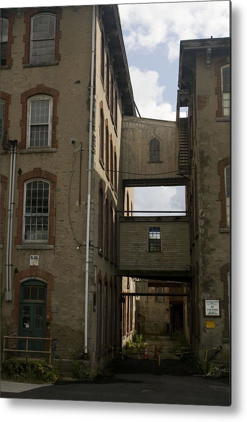 Mill Metal Print featuring the photograph Rundown Alley by Jeff Porter