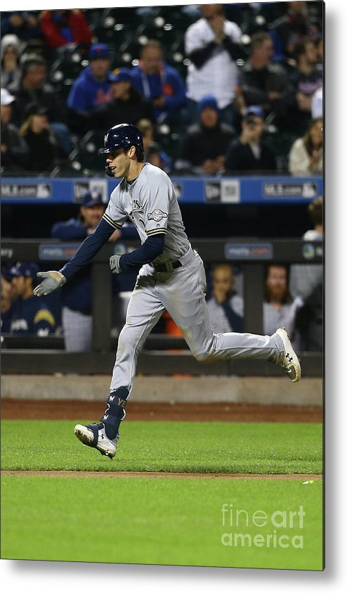 American League Baseball Metal Print featuring the photograph Mike Moustakas And Christian Yelich by Mike Stobe