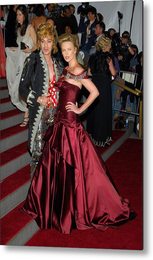 Anglomania Tradition And Transgression In British Fashion Opening Gala Metal Print featuring the photograph John Galliano, Charlize Theron Wearing by Everett