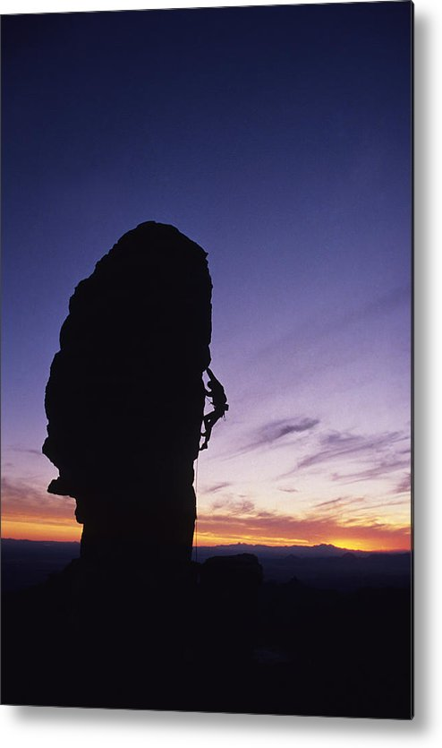 One Person Metal Print featuring the photograph A Climber Leads A Route Up A Spire by Bill Hatcher