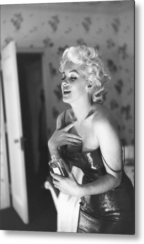 People Metal Print featuring the photograph Marilyn Monroe With Chanel No. 5 by Michael Ochs Archives
