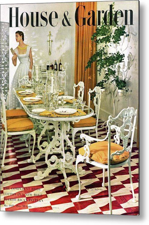 Magazine Metal Print featuring the photograph A House And Garden Cover Of A Woman In A Dining by Horst P. Horst