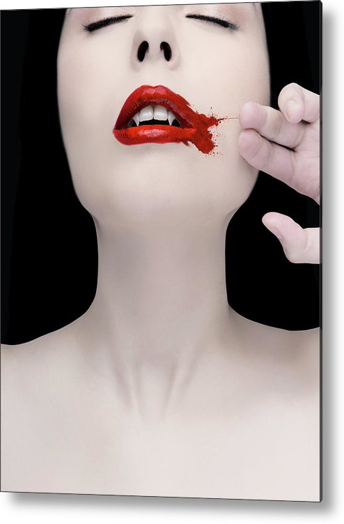 People Metal Print featuring the photograph A Vampire Wiping Blood From Her Mouth by Colin Anderson