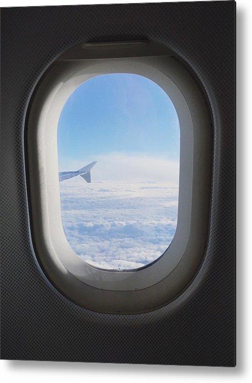 Cloudy Sky Seen Through Airplane Window Metal Print By Gen