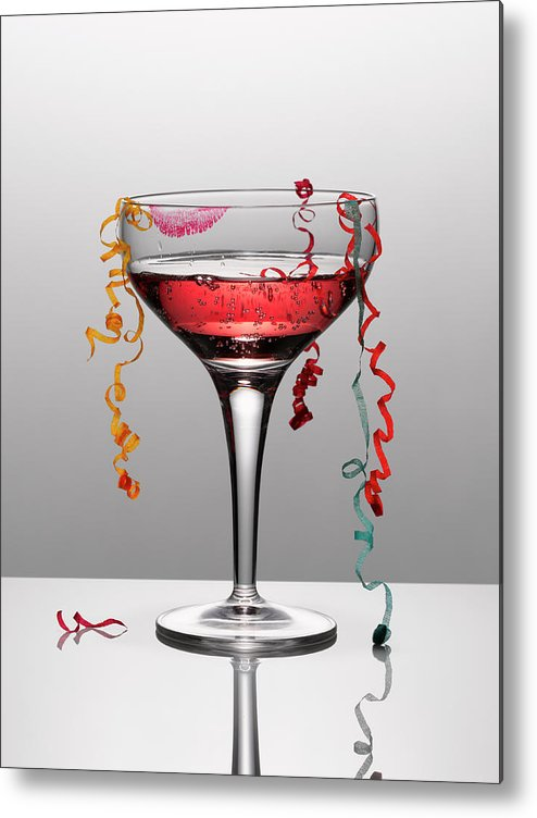 Streamer Metal Print featuring the photograph Confetti Hanging From Glass Of Pink by Andy Roberts