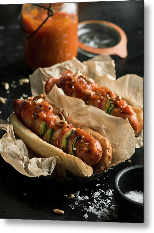 Unhealthy Eating Metal Print featuring the photograph Hot Dogs by Johner Images
