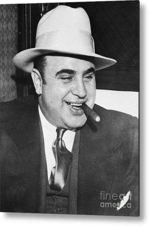 Al Capone Metal Print featuring the photograph Gangster Al Capone Smoking Cigar by Bettmann
