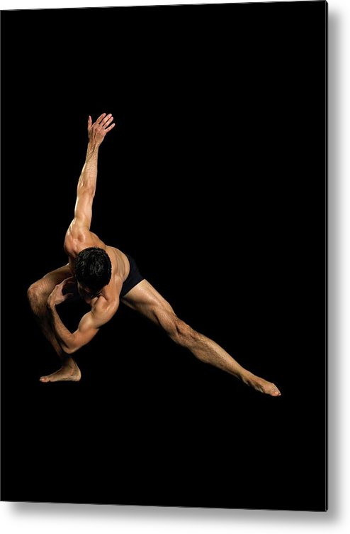 Human Arm Metal Print featuring the photograph Male Dancer Performing by Image Source