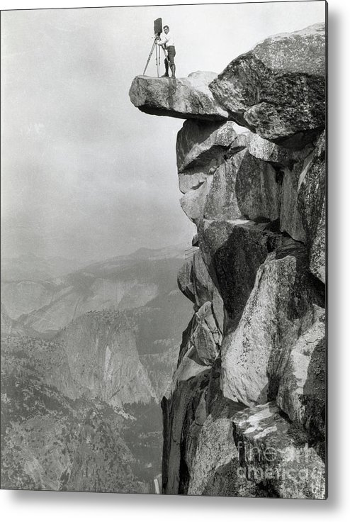 People Metal Print featuring the photograph Photographer Standing On Mountain Ledge by Bettmann