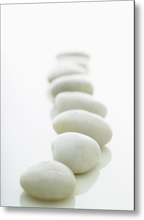 White Background Metal Print featuring the photograph White Stones Lined Up On A White by Rick Lew
