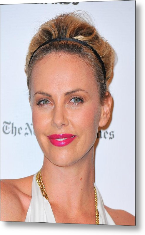 Charlize Theron Metal Print featuring the photograph Charlize Theron Wearing A Jennifer Behr by Everett