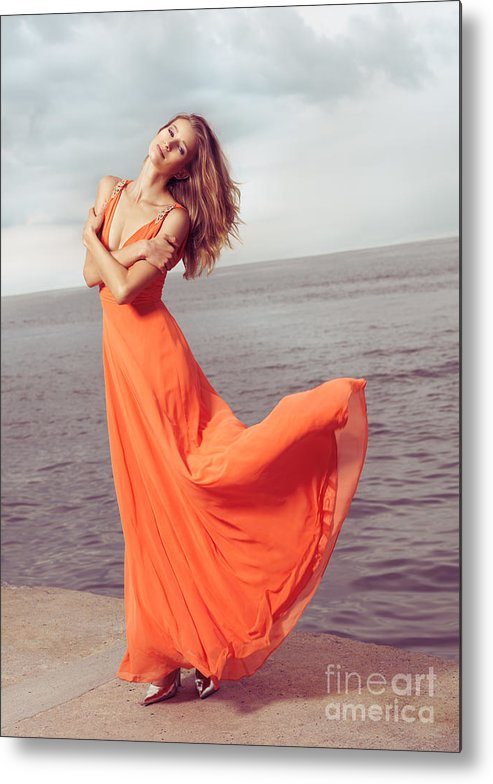 Woman Metal Print featuring the photograph Young Woman In Orange Dress Flying In The Wind At Sea Shore by Oleksiy Maksymenko