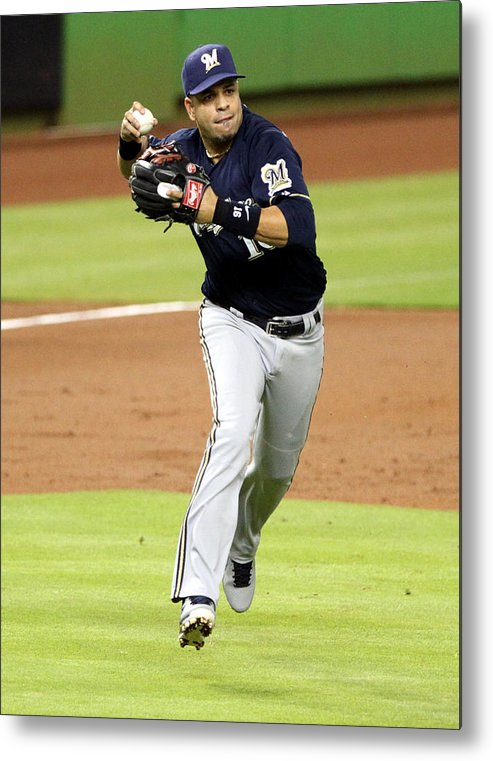 American League Baseball Metal Print featuring the photograph Milwaukee Brewers V Miami Marlins by Marc Serota
