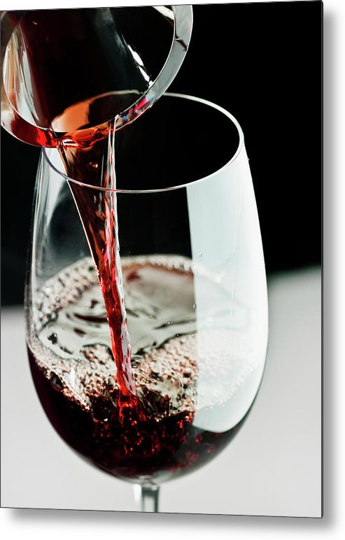 Alcohol Metal Print featuring the photograph Red Wine Being Poured In A Glass by Juanmonino