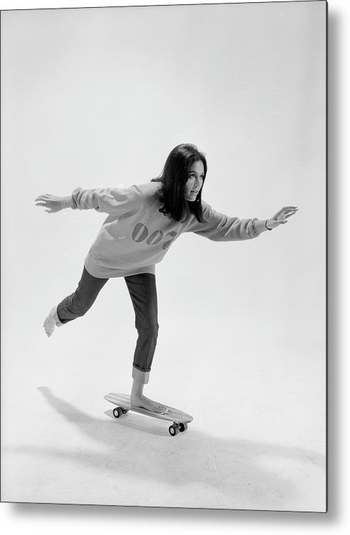 Timeincown Metal Print featuring the photograph Gloria Steinem On A Skateboard by Yale Joel