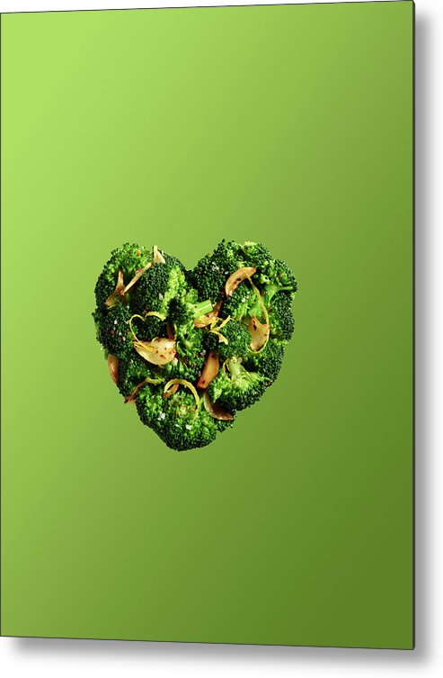Broccoli Metal Print featuring the photograph Heart Shaped Broccoli On Green by Maren Caruso