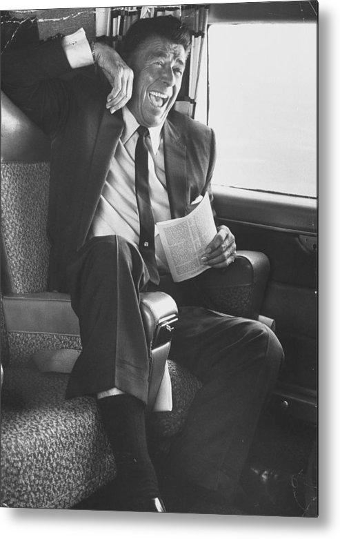 Celebration Metal Print featuring the photograph Jubilant Ronald Reagan Celebrating His by John Loengard