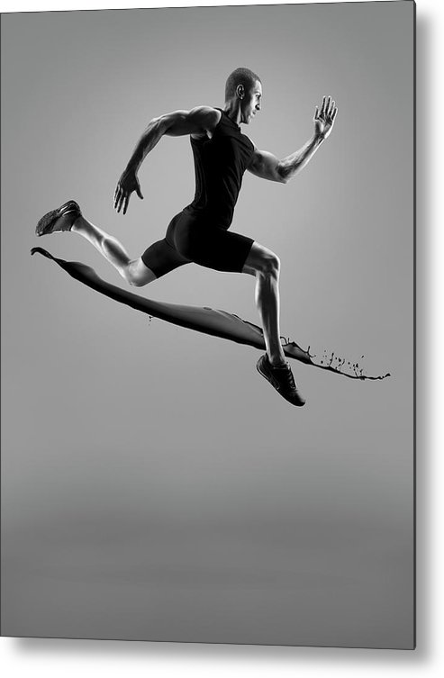People Metal Print featuring the photograph Male Athlete Running Above Liquid Splash by Jonathan Knowles