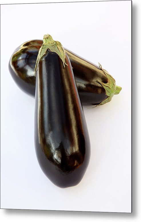 White Background Metal Print featuring the photograph Ripe, Organic Aubergines On White by Rosemary Calvert
