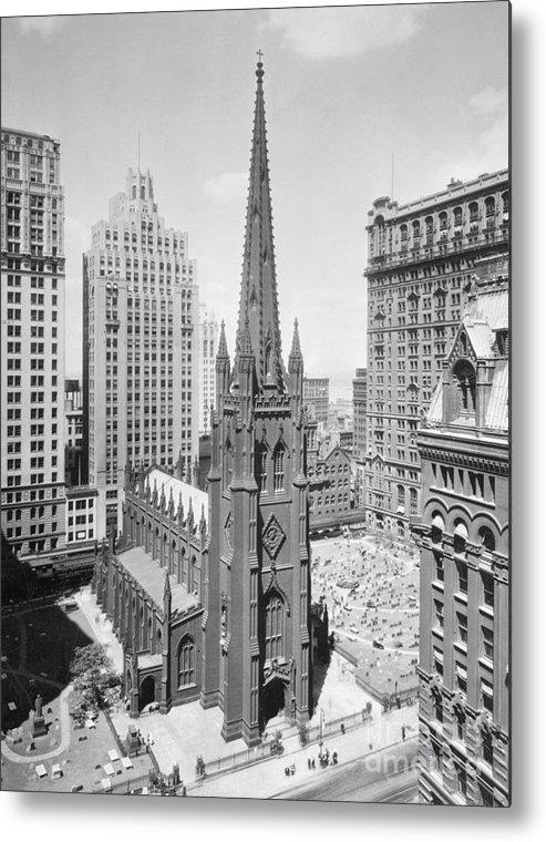 1930-1939 Metal Print featuring the photograph Trinity Church On Wall Street by Bettmann