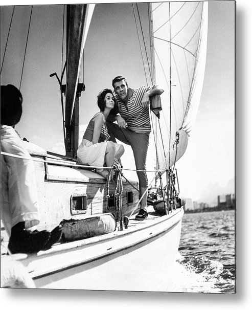 Outdoors Metal Print featuring the photograph Models On A Sailboat by Richard Waite
