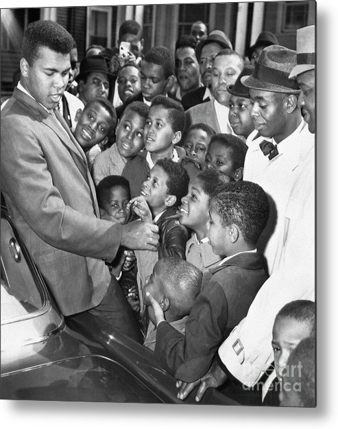 Crowd Of People Metal Print featuring the photograph Muhammad Ali With Boys In Boston by Bettmann
