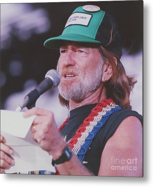 1980-1989 Metal Print featuring the photograph Willie Nelson Reading Letter by Bettmann