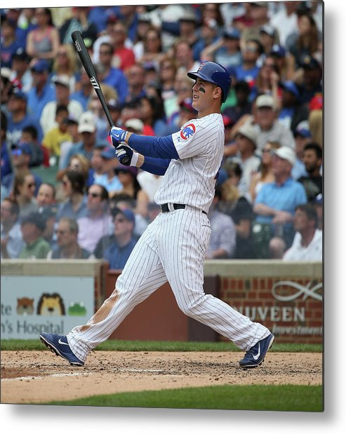 Following Metal Print featuring the photograph Anthony Rizzo by Jonathan Daniel