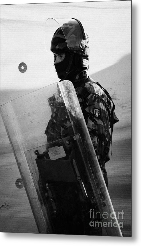 Northern Metal Print featuring the photograph British Army Soldier With Helmet And Shield Riot Gear On Crumlin Road At Ardoyne Shops Belfast 12th by Joe Fox