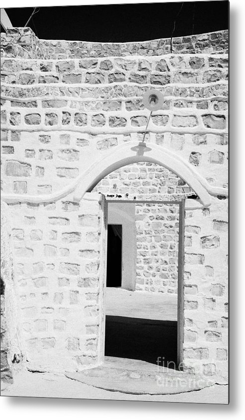 Tunisia Metal Print featuring the photograph close up of front doorway entrance to family home berber troglodyte underground dwelling at Matmata Tunisia by Joe Fox