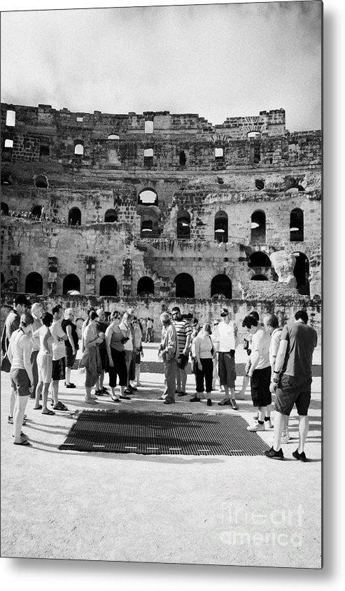 Tunisia Metal Print featuring the photograph Tour Guide Explains To Group Of British Tourists About Gladiator Pits On The Floor Of The Arena Of The Old Roman Colloseum At El Jem Tunisia Vertical by Joe Fox