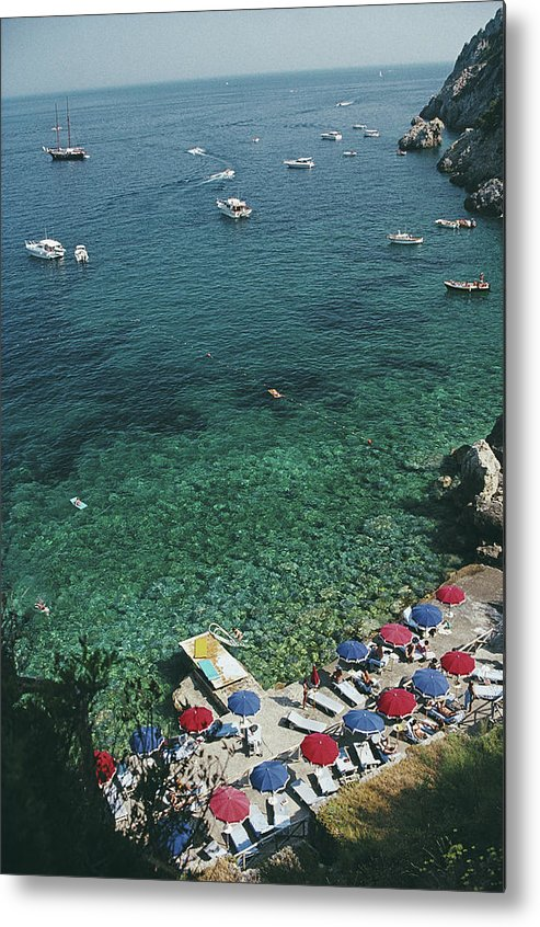 Sunbathing Metal Print featuring the photograph View From Il Pellicano by Slim Aarons
