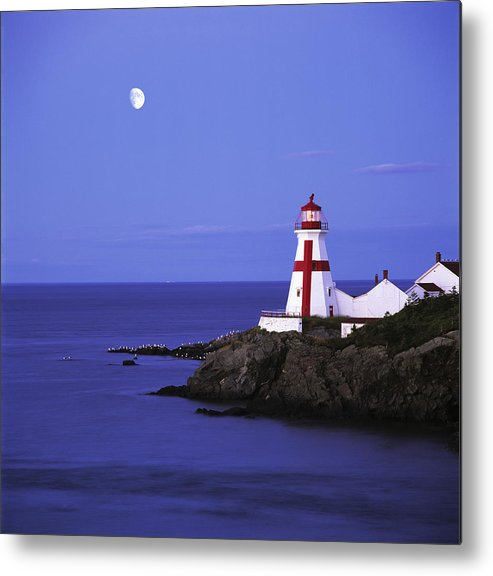 Light Metal Print featuring the photograph Lighthouse In Moon Light by Claude Bouchard
