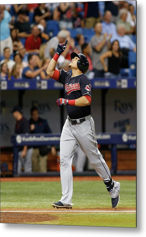 Following Metal Print featuring the photograph Cleveland Indians V Tampa Bay Rays by Brian Blanco