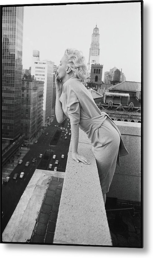 Smoking Metal Print featuring the photograph Marilyn On The Roof by Michael Ochs Archives