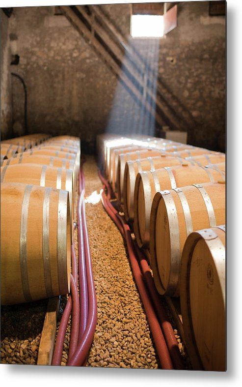 Alcohol Metal Print featuring the photograph Barrels In Wine Cellar by Johner Images
