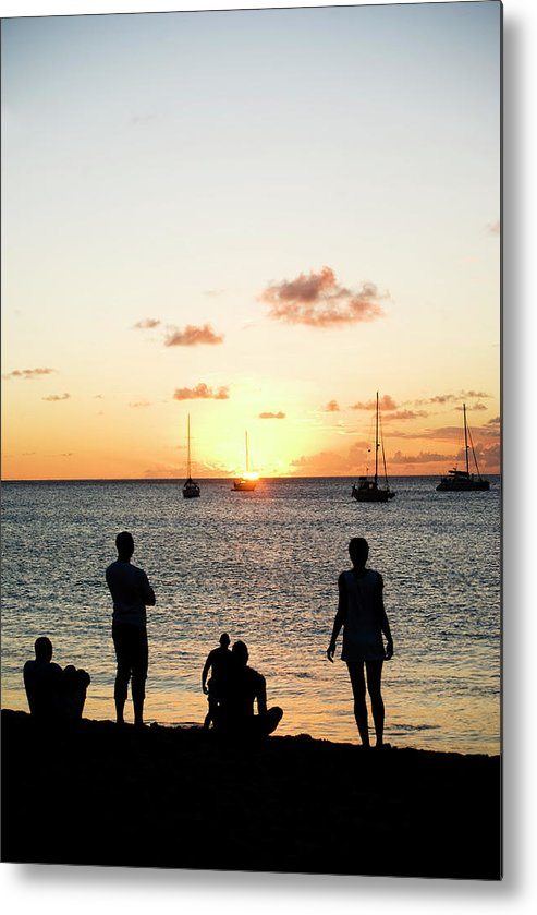 Recreational Pursuit Metal Print featuring the photograph Group Of Young Friends On Beach At by Jaminwell