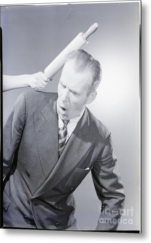 People Metal Print featuring the photograph Husband Being Hit With Rolling Pin by Bettmann