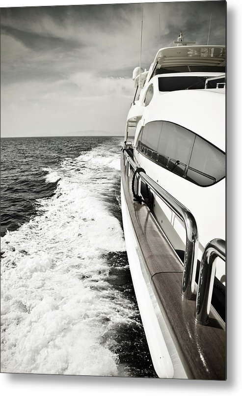 Desaturated Metal Print featuring the photograph Luxury Yacht Sailing At High Speed In by Petreplesea