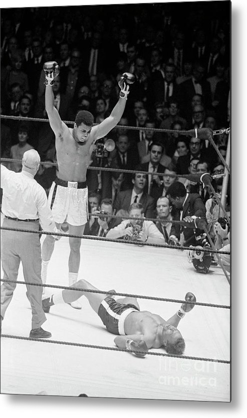 Human Arm Metal Print featuring the photograph Muhammad Ali Knocks Out Cleveland by Bettmann